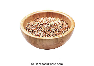 Buckwheat in bowl isolated on white background.