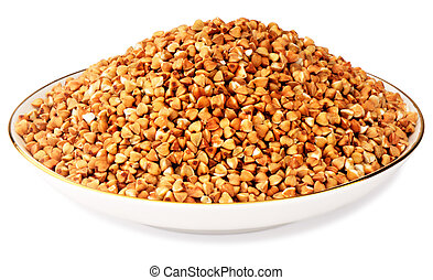 Seeds of buckwheat in porcelain plate over white background