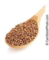 buckwheat in spoon on white