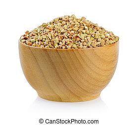Buckwheat in wood bowl isolated on white background
