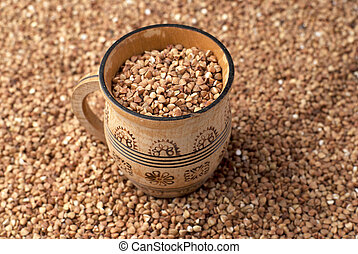 buckwheat in wooden cup