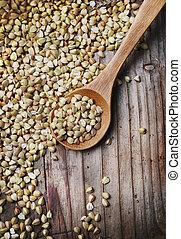 Buckwheat in wooden spoon