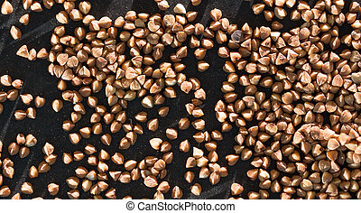 buckwheat on a black background