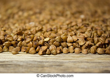 Buckwheat on wooden background