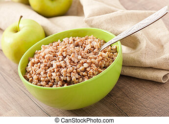buckwheat porridge and green apple - diet concept