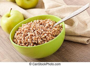 buckwheat porridge and green apple - diet concept