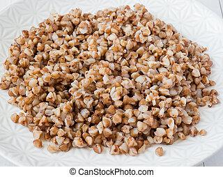 Buckwheat porridge in a plate, healthy food.