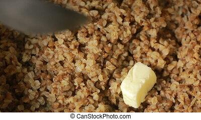 buckwheat porridge with butter. stirring spoon