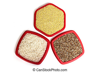 buckwheat, rice and wheat on a white background
