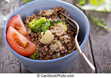 Buckwheat with mushrooms and vegetables in a bowl