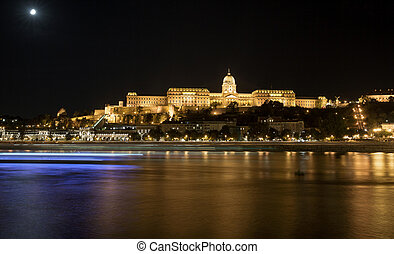 Buda Castle by Danube river at night. Budapest, Hungary.