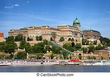 Buda Castle (Royal Palace) and passenger boats on the Danube River in Budapest, Hungary.