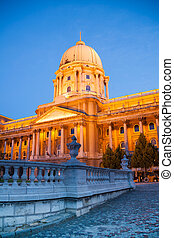 Buda Castle in golden lights at night Budapest