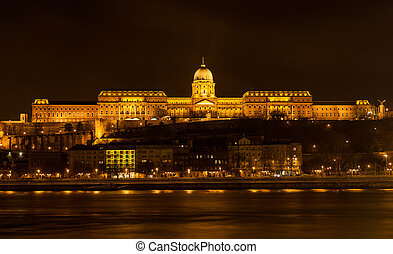 Buda Castle (Royal Palace) by the Danube river illuminated at night in Budapest, Hungary