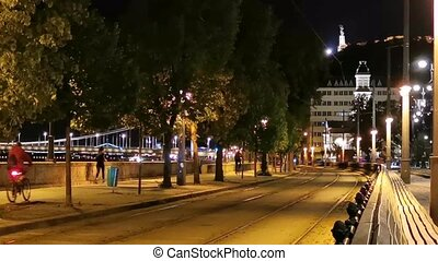 Budapest at Night - Buda Side Street Scene - People jogging and biking along the Danube River at Night
