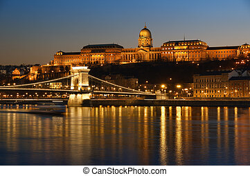 Hungarian landmarks, Chain Bridge, Royal Palace and Danube river in Budapest at night.