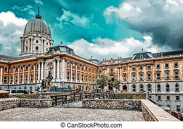 BUDAPEST, HUNGARY-MAY 03, 2016 :Budapest Royal Castle -Courtyard of the Royal Palace in Budapest with construction equipment in the backyard with people.