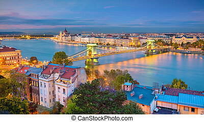 Panoramic cityscape image of Budapest, capital city of Hungary, during sunset.