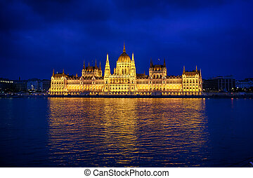 Budapest Parliament at night with reflection in Danube river