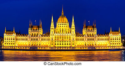 Budapest Parliament at night with reflection in Danube river...