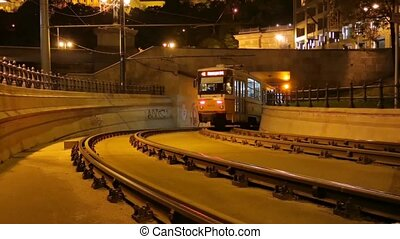 Low Angle view of a slowly passing Budapest Trolley / Tram at Night