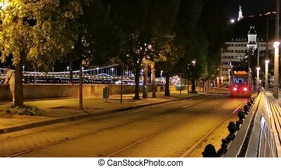 Budapest Tram / Street Car passing close by at Night near the Budapest castle on the Buda side of the city.