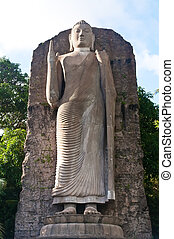 Budda - The big stone statue of Budda is pointing with its...