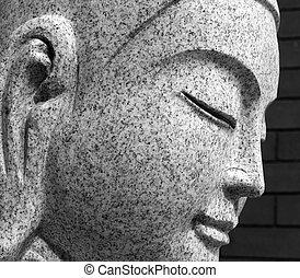 Buddha face - Closeup of the face of a granite buddha...