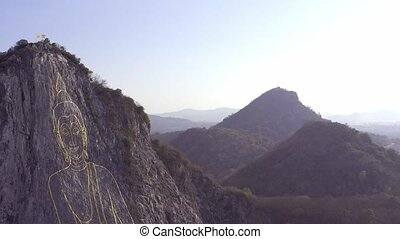 Buddha images the carved On the mountain. Buddha Mountain in...