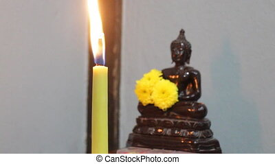 Buddha meditation with candle flame, stock video