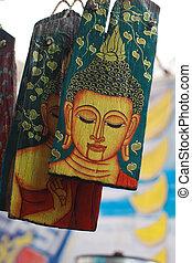 Buddha on a Piece of Wood