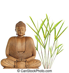 Abstract of a wooden buddha in meditation with bamboo grass to one side, over white background.
