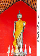 Buddha, stand on red background, Thailand temple