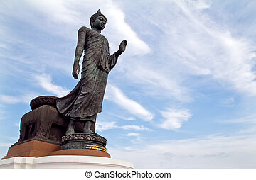 buddha statue against blue sky in thai temple