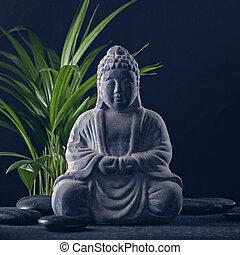 Buddha statue and stones