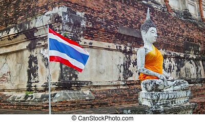 Buddha statue and Thai flag in the temple - Video 1080p -...