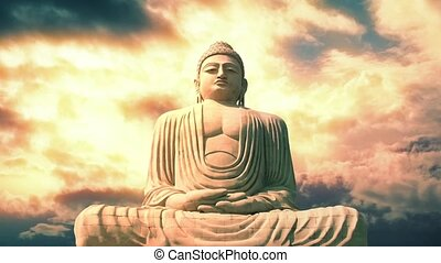 Huge stone statue of the Buddha in meditating position with amazing sky