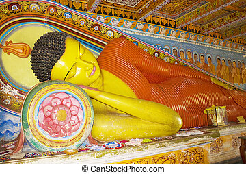 Image of a Buddha statue at the ancient 3rd century Isurumuniya Temple, Anuradhapura, Sri Lanka. This is a UNESCO World Heritage Site.