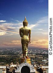 Buddha statue at sunset Rear view