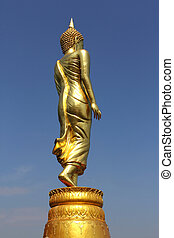 Buddha statue at sunset  Rear view