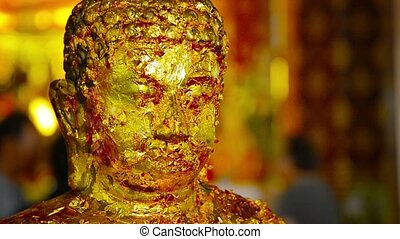 Buddha Statue Covered in Gold Leaf Offerings in Ayutthaya,...