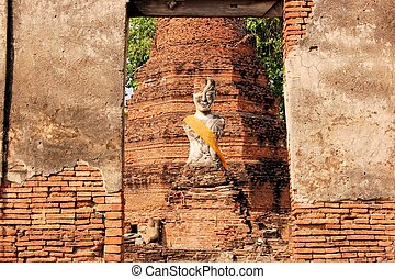 Buddha statue in Ancient city of Ayutthaya, Thailand - Half...