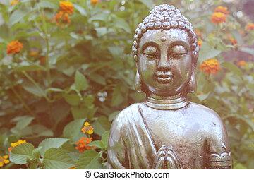 Buddha Statue in Garden with green background