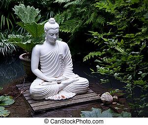Buddha statue in pond - Statue of Buddha on wooden platform...