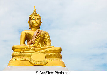 Buddha statue on blue sky as background