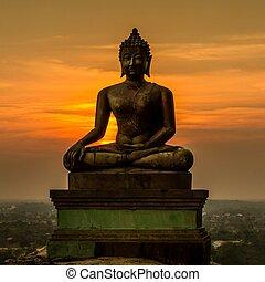 Buddha statue on sunset at Saraburi, Thailand
