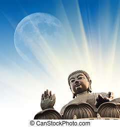 Buddha statue in rays of light over blue sky.