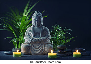 Buddha statue, stones and candles