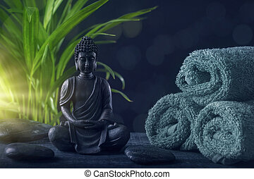 Buddha statue ,towels and stones