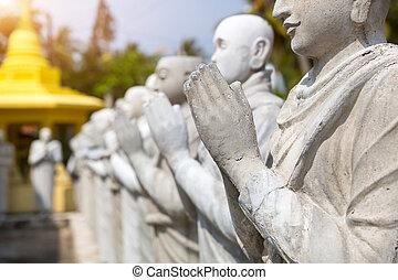 Buddha statues in a temple on Sri Lanka closeup
